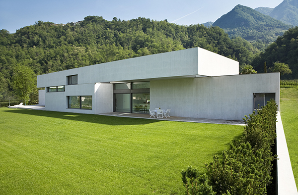 Outdoors modern minimalist house with a flat roofing system